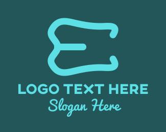 Dentist - Tooth Letter E logo design