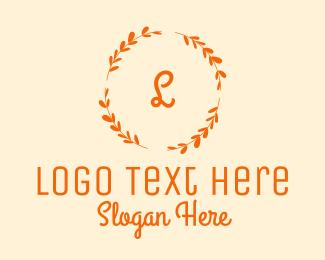 Dress Shop - Elegant Gold Floral Wreath Cursive Letter logo design