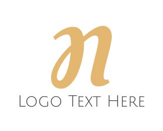 Letter N - Gold Cursive Letter N logo design