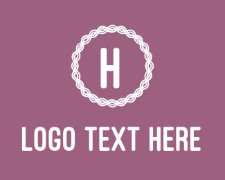 Knitting - Pink Embroidered H logo design