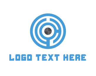 Shield - Maze Target logo design