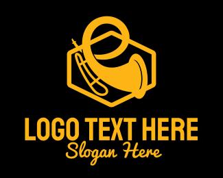 Jazz Club - Gold Trumpet Silhouette logo design