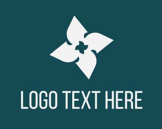 Propeller - Blade Flower logo design