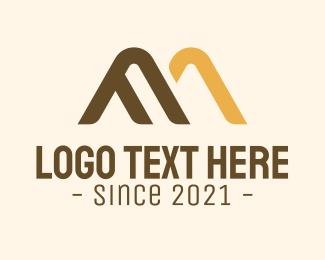 Adventurer - Mountain Letter M logo design