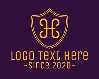 Defend - Golden Shield Letter H logo design