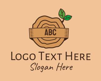Camp Site - Tree Trunk Lettermark logo design