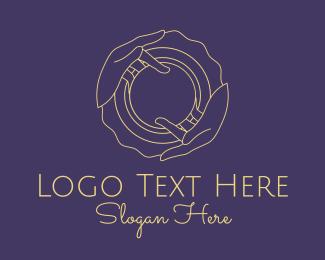 Illusionist - Minimalist Hand Orb logo design