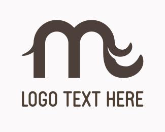 Pachyderm - Letter M Elephant logo design