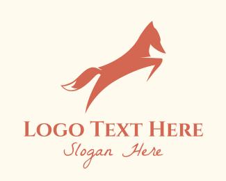 Coyote - Orange Fox Leaping logo design