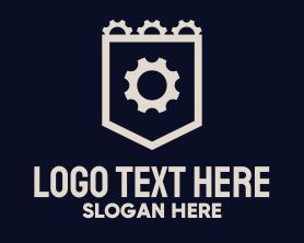 Steampunk - Gray Cogwheel Emblem logo design