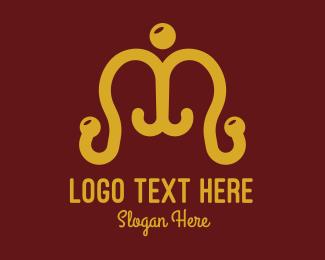 Brass - Coat Hanger Letter M logo design