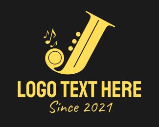 Drumming - Golden Saxophone Letter J logo design
