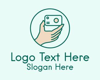 Photographer Hand  Logo