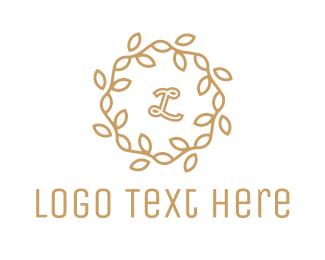 """Golden Wreath Lettermark"" by Zdesign"