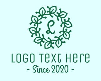 Christmas Decoration - Green Leaves Lettermark Wreath logo design