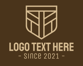 """""""Brown Shield Letter T"""" by RistaDesign"""