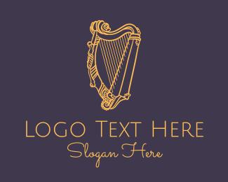Lyre - Golden Ornate Harp logo design