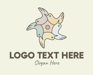 Unity - Community Bird Flower logo design