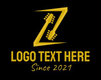 Initial - Golden Guitar Letter Z logo design