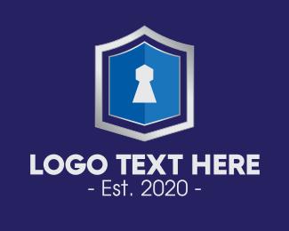 Defend - Metallic Keyhole Shield logo design