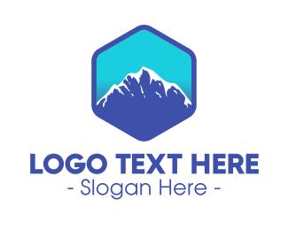Landmass - Blue Hexagon Mountain Peak logo design