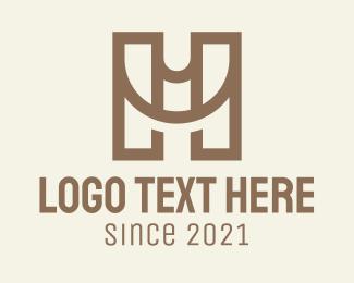 HU Monogram Logo