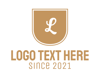 Shield - Golden Letter Emblem logo design
