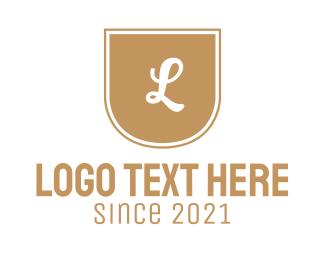 """""""Golden Letter Emblem"""" by BrandCrowd"""