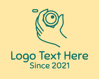 Imaging - Camera Lens Hand  logo design