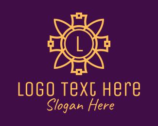 Textile Design - Gold Flower Ornament Letter logo design