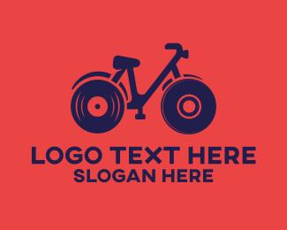 Dvd - Vinyl Record Bicycle logo design