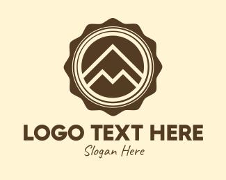 Adventurer - Outdoor Mountain Badge logo design