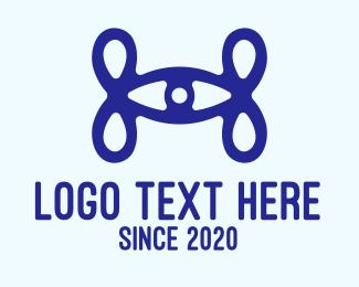 Loop - Blue Eye Loop Letter H logo design