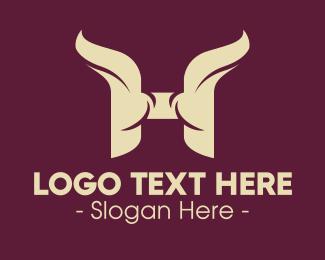 Yak - Horn Letter H logo design