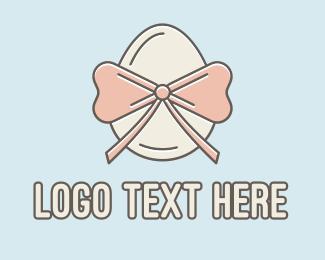 Egg - Ribbon Decorated Egg logo design