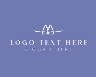 Motel - Cursive Letter M logo design