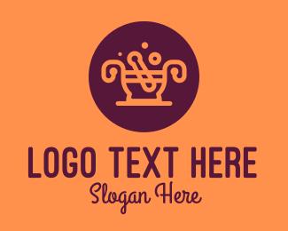 Traditional Medicine - Orange Mortar & Pestle logo design