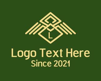 Eagle - Tribal Wings Lettermark logo design