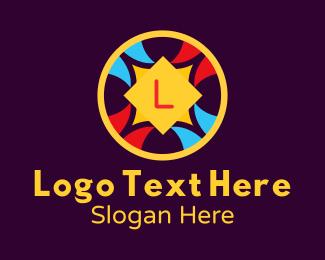 Ornamental - Festive Ornamental Letter logo design