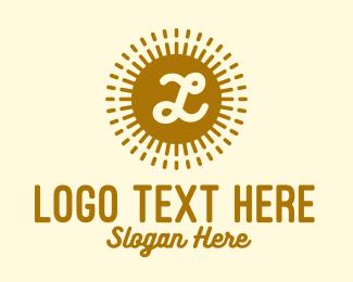 Letter - Gold Sun Lettermark  logo design