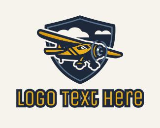 Aeronautics - Parasol Wing Monoplane Flight Badge logo design