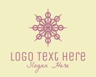 Decorate - Purple Intricate Snowflake Decor logo design