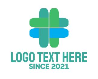 """Blue & Green Medical Cross"" by LogoBrainstorm"