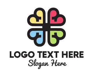Four Leaf Clover - Heart Flower logo design