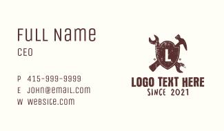 Grunge Mechanic Shield Letter Business Card