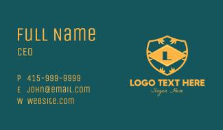 Golden Ornate Lettermark Business Card