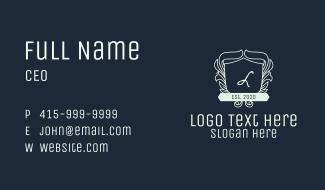 White Ornate Wreath Shield Lettermark Business Card